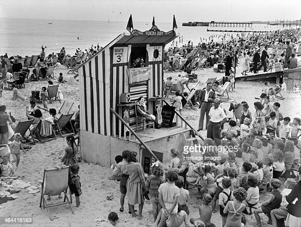Punch and Judy show Lowestoft Suffolk August 1949 Children watching a Punch and Judy show on the beach at Lowestoft at a charge of 3d Lowestoft Pier...