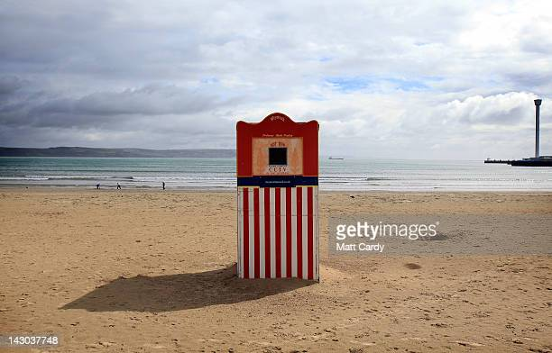 Punch and Judy traditional puppet show theatre is set up on the seafront of Weymouth Bay which will be the venue for the London 2012 Olympic and...