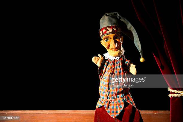 punch from the classic puppet show punch and judy sitting on stage - puppet show stock photos and pictures