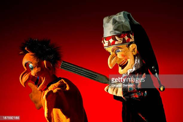 punch from the classic puppet show punch and judy threatens the devil with a weapon - puppet show stock photos and pictures