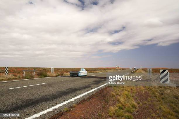 Punch Powertrain Solar Team vehicle 'Punch Two' from Belgium races in the Challenger Class crosses a cattle grid as it races outside of Coober Pedy...