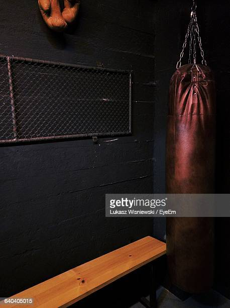 Punching Bag Hanging Against Wall At Home