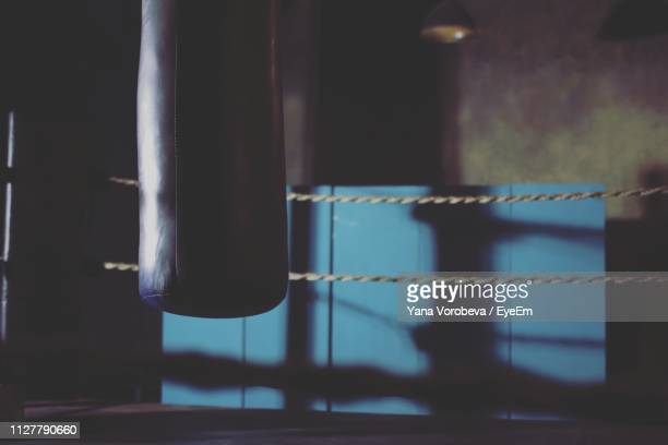 punching bag hanging in boxing ring - boxing ring stock pictures, royalty-free photos & images
