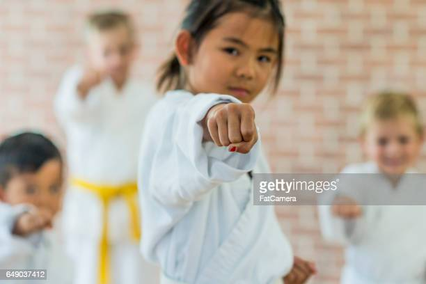 punching in class - taekwondo kids stock photos and pictures