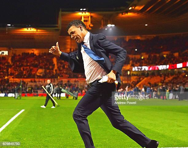 TV pundit Chris Kamara makes a last minute dash for the tv studio before the Premier League match between Middlesbrough and Liverpool at Riverside...