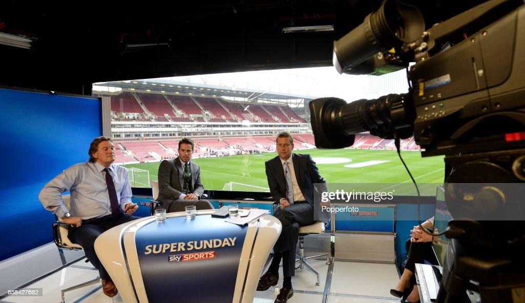Pundits Glenn Hoddle and Jamie Redknapp with Presenter Ed Chamberlain watch the Barclays Premier League match between Everton and Arsenal during the live broadcast of the Sky Sports show Super Sunday Football in London, England on April 6, 2014.