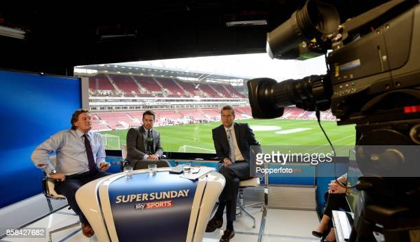 Pundits Glenn Hoddle and Jamie Redknapp with Presenter Ed Chamberlain watch the Barclays Premier League match between Everton and Arsenal during the...