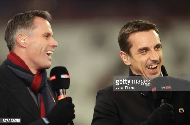 Pundits Jamie Carragher and Gary Neville laugh prior to the Premier League match between West Ham United and Leicester City at London Stadium on...
