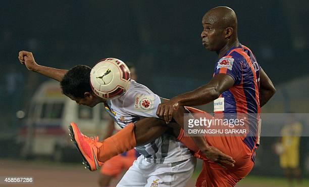 FC Pune City footballer Dudu Omagbemi and Atletico de Kolkata footballer Kinshuk Debnath tussle for the ball during the Indian Super League football...