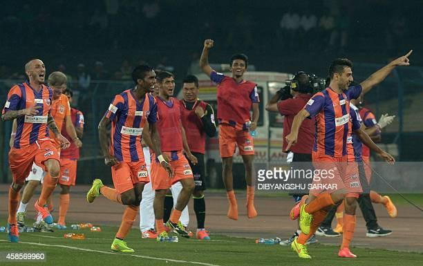 FC Pune City footballer Kostas Katsouranis celebrates after scoring his team's second goal during the Indian Super League football match between...