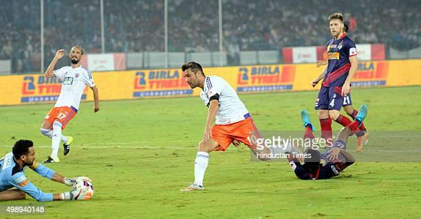 Pune City forward Adrian Mutu in action as Atletico De Kolkata Goalkeeper saves the ball during ISL match at Saltlake Stadium on November 272015...