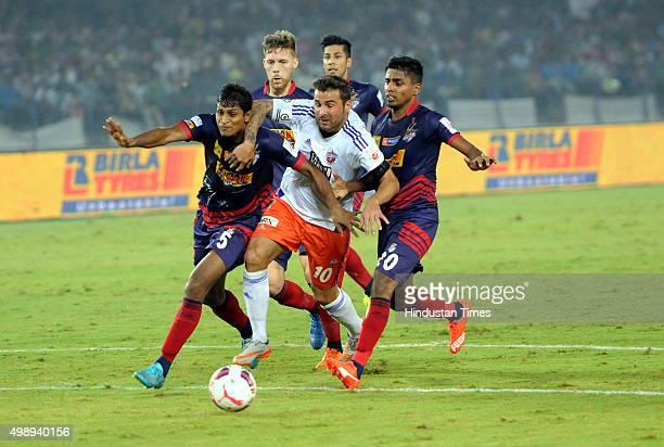 Pune City forward Adrian Mutu vying for the ball with Atletico De Kolkata players during ISL match at Saltlake Stadium on November 272015 Kolkata...
