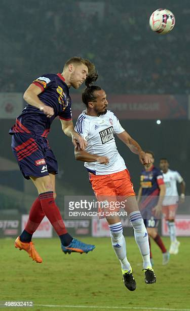 FC Pune City midfielder Tuncay Sanli vies for the ball with AtleticodeKolkata's defender Jose Luis Espinosa Arryo during the Indian Super League...