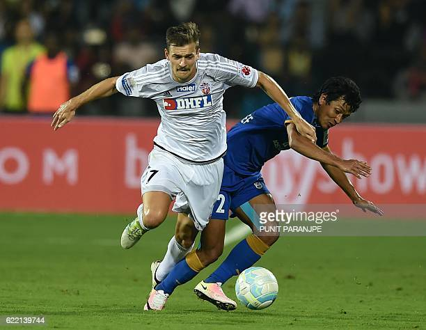 FC Pune City player Jonatan Lucca vies for the ball during the Indian Super League football match between FC Pune City and Mumbai City FC at The...