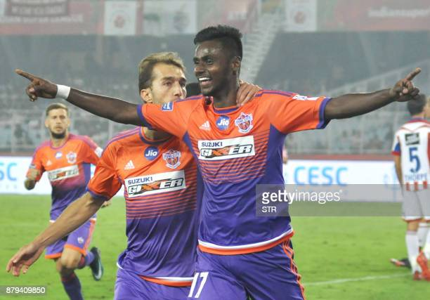 FC Pune City player Rohit Kumar celebrates after scoring a goal during the Indian Super League football match between ATK and FC Pune City at The...