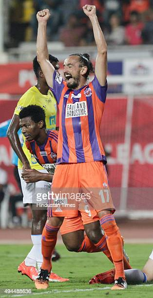 Pune City players Tuncay Sanli and Kalu Uche in action against Kerala Blasters FC during a match of Hero Indian Super League 2015 at Shree...