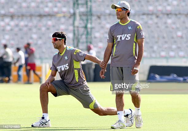 Pune Warriors captain Saurav Ganguly with teammate Ashish Nehra during the practicing session at PCA stadium on April 11 2012 in Mohali India Pune...