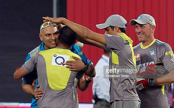 Pune Warriors player Yuvraj Singh joins teammates prior to the match between Pune Warriors and Deccan Chargers at Subrata Roy Sahara Stadium on April...