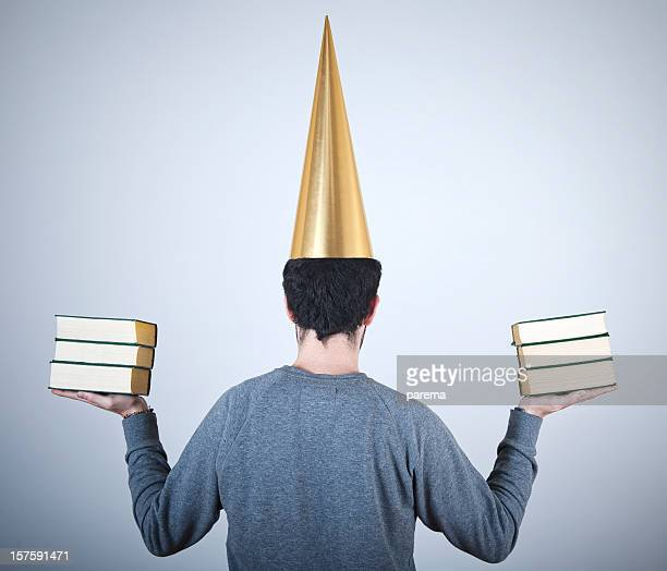 punished, - dunce's hat stock pictures, royalty-free photos & images
