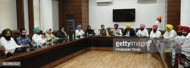 Punjab AAP and Lok Insaf party legislators holding a meeting to chalk out their strategy at state assembly after Delhi Chief Minister and AAP...