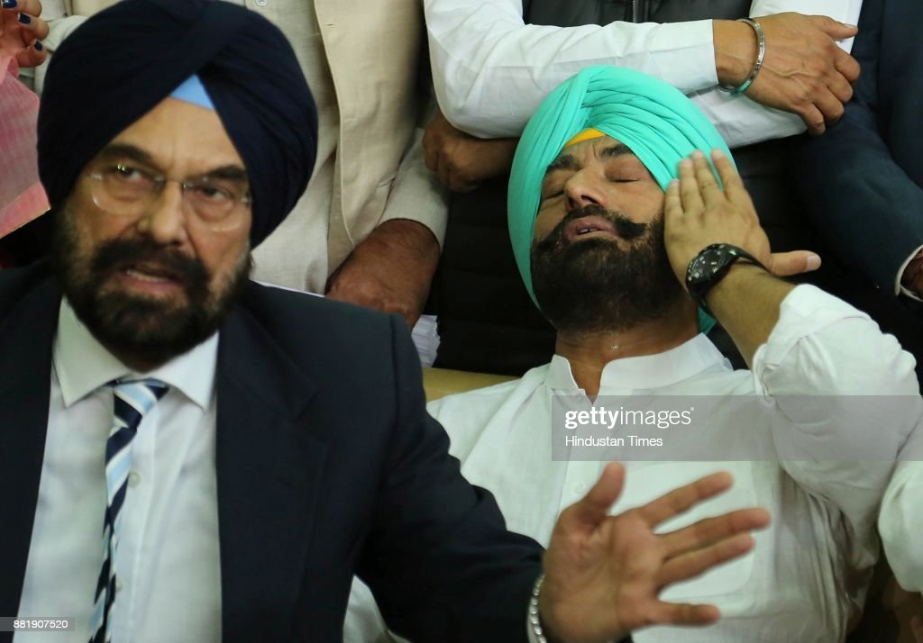 Punjab AAP MLA Kanwar Sandhu addressing media while AAP leader Sukhpal Singh Khaira being emotional during press conference in at Punjab Vidhan Sabha.