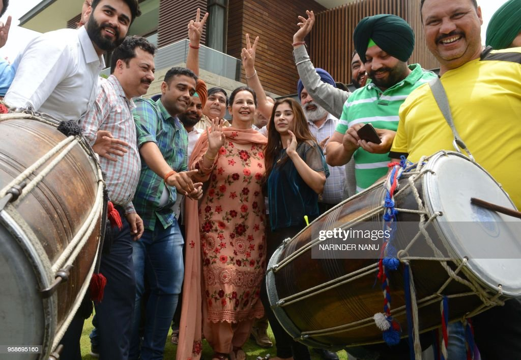 Punjab cabinet minister and former cricketer Navjot Singh Sidhu wife Navjot Kaur Sidhu along with her daughter Rabia Sidhu celebrate after the...