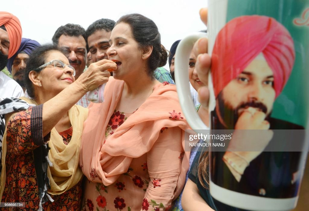 Punjab cabinet minister and former cricketer Navjot Singh Sidhu wife Navjot Kaur Sidhu receives a sweet ladoo by her mother Paramjit Kaur as they...