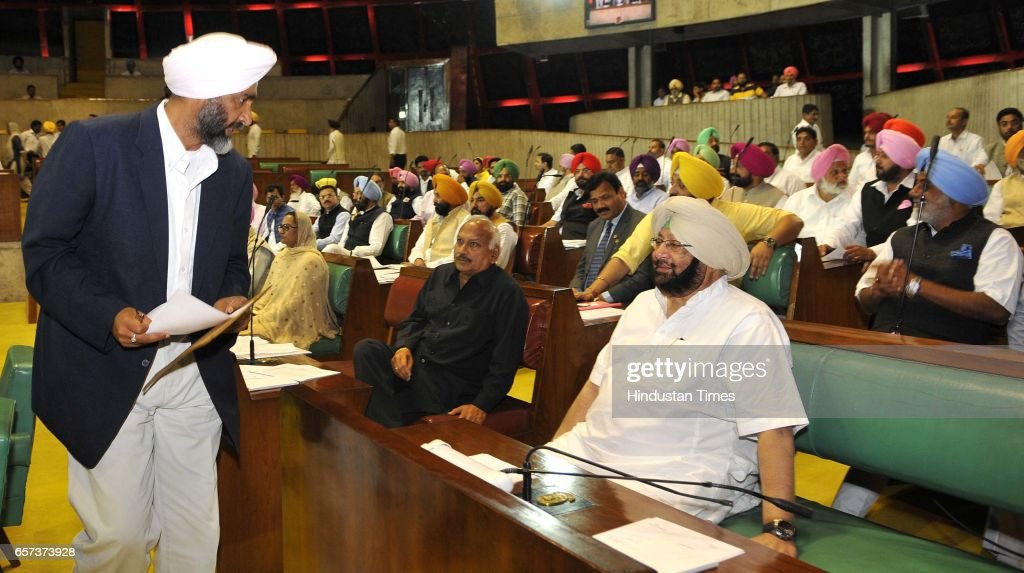 Punjab Cabinet Minister Manpreet Badal interacting with CM Capt Amrinder Singh on the first day of Punjab Vidhan Sabha session on March 24 2017 in...