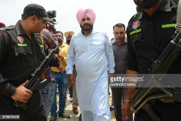 Punjab Cabinet Minister Navjot Singh Sidhu arrives during a press conference to boost tourism in Punjab state at the War Memorial Museum in Amritsar...
