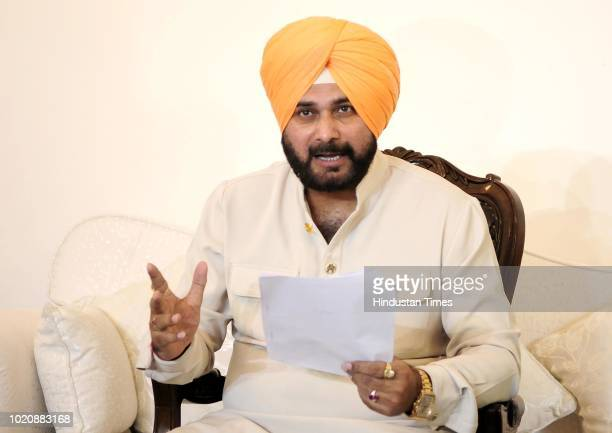 Punjab Cabinet Minister Navjot Singh Sidhu gestures during a press conference on August 21 2018 in Chandigarh India Punjab Cabinet Minister Navjot...