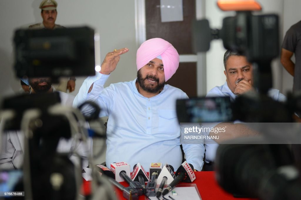 Punjab Cabinet Minister Navjot Singh Sidhu speaks during a press conference to boost tourism in Punjab state at the War Memorial Museum in Amritsar...