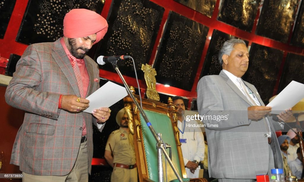 Punjab Cabinet Minister Navjot Singh Sidhu taking oath on the first day of Punjab Vidhan Sabha session on March 24 2017 in Chandigarh India