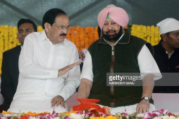 Punjab Chief Minister Amarinder Singh listens to Indian Vice President M Venkaiah Naidu during the foundation stonelaying ceremony for the planned...