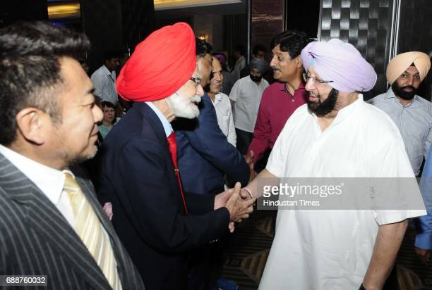 Punjab Chief Minister Capt Amarinder Singh meeting with Balbir Senior former hockey player during HT Youth Forum on May 26 2017 in Chandigarh India
