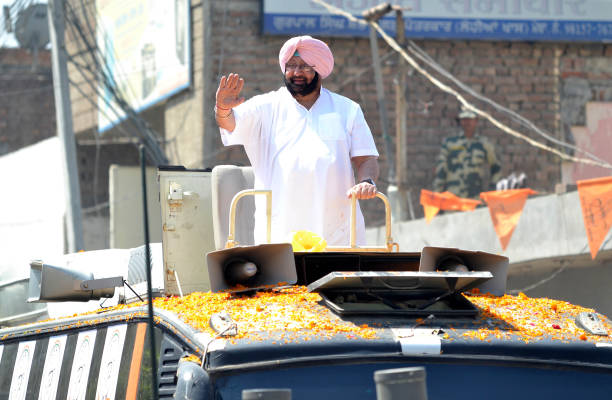 Punjab Chief Minister Capt Amarinder Singh waving to congress supports during road show ahead of Shahkot By poll in Lohain Khas on May 26 2018 in...