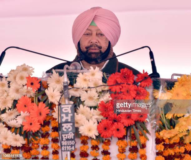 Punjab Chief Minister Captain Amarinder Singh addresses during the foundation laying ceremony of Kartarpur corridor at Dera Baba Nanak in district...