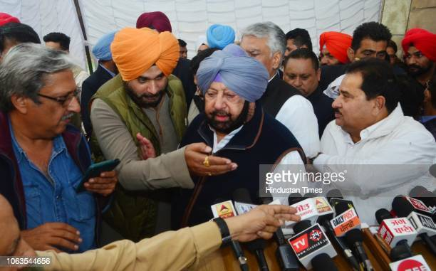 Punjab Chief Minister Captain Amarinder Singh along with Punjab Local Bodies Minister Navjot Singh Sidhu Punjab School Education Minister OP Soni and...