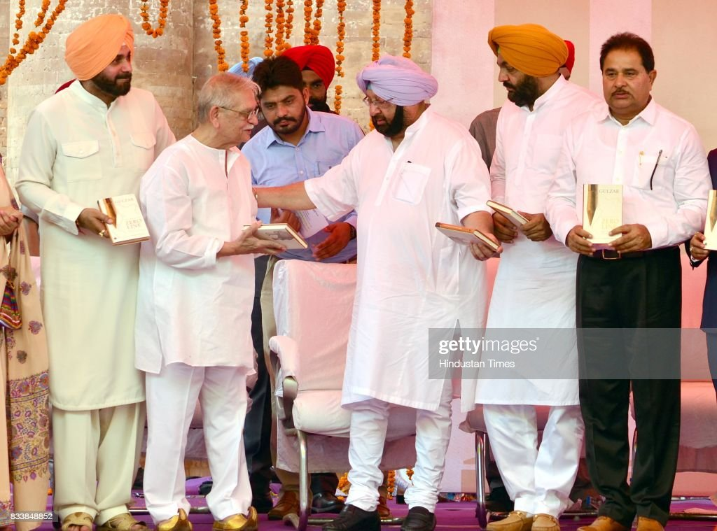 Punjab Chief Minister Captain Amarinder Singh (2R), Notable Indian Poet, Writer, Lyricist and Film Director Gulzar (2L), Punjab Local Bodies Minister Navjot Singh Sidhu (L), MP Gurjit Singh Aujla (R) and MLA OP Soni (R) after the launch of Gulzar book Footprints On Zero Line writing on Partition during the inauguration of Partition Museum at Town Hall, on August 17, 2017 in Amritsar, India.