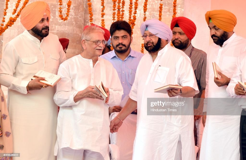 Punjab Chief Minister Captain Amarinder Singh (2R), Notable Indian Poet, Writer, Lyricist and Film Director Gulzar (2L), Punjab Local Bodies Minister Navjot Singh Sidhu (L) and MP Gurjit Singh Aujla (R) after the launch of Gulzar book Footprints On Zero Line writing on Partition during the inauguration of Partition Museum at Town Hall, on August 17, 2017 in Amritsar, India.