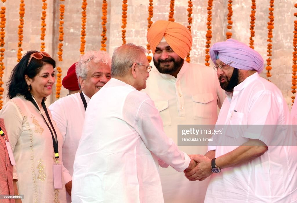 Punjab Chief Minister Captain Amarinder Singh shakes hand with the Notable Indian Poet, Writer, Lyricist and Film Director Gulzar in the presence of Punjab Local Bodies Minister Navjot Singh Sidhu, CEO of Partition Museum Kishwar Desai during the inauguration of Partition Museum at Town Hall, on August 17, 2017 in Amritsar, India.
