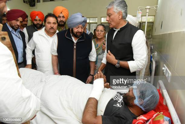 Punjab Chief Minister Captain Amarinder Singh visits a victim of grenade blast at Guru Nanak Dev Hospital on November 19 2018 in Amritsar India