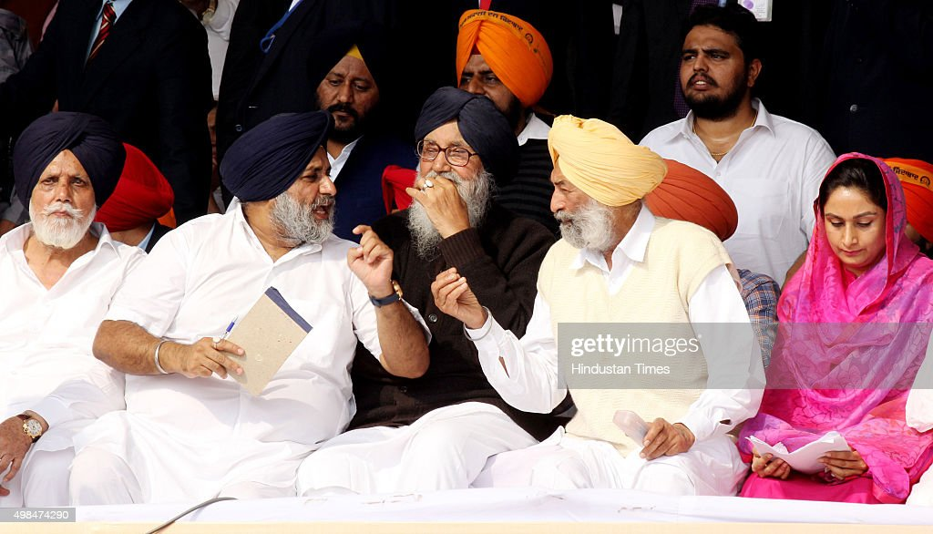Punjab Chief Minister Parkash Singh Badal Punjab Deputy Chief Minister Sukhbir Singh Badal MP Balwinder Singh Bhunder talking with each other during..