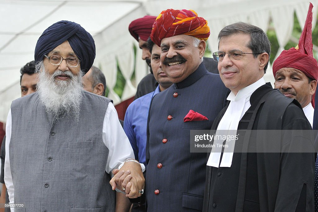 Punjab CM Parkash Singh Badal Punjab New Governor VP Singh Badnore and Punjab Haryana High Court Chief Justice Shiavax Jal Vazifdar during the oath...
