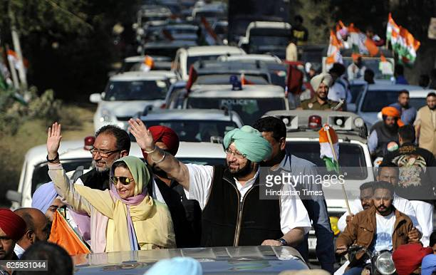 Punjab Congress Chief Amarinder Singh along with his wife MLA Preneet Kaur and congress leader Madanlal Jalalpur during roadshow at Ghanour on...