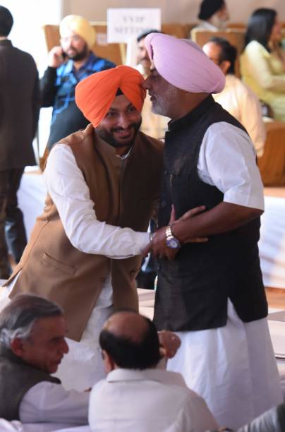 Punjab congress leader Ravneet Singh Bittu and Randeep Singh Nabha during Amrinder Singh oath ceremony at Punjab Raj Bhawan on March 16 2017 in...
