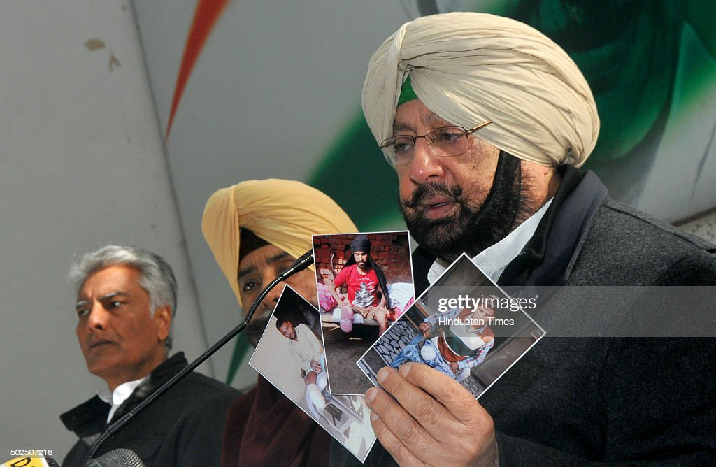 Punjab Congress President Capt Amrinder Singh showing the pictures of victims during the press conference at Punjab Congress Bhawan in sector 15 on...
