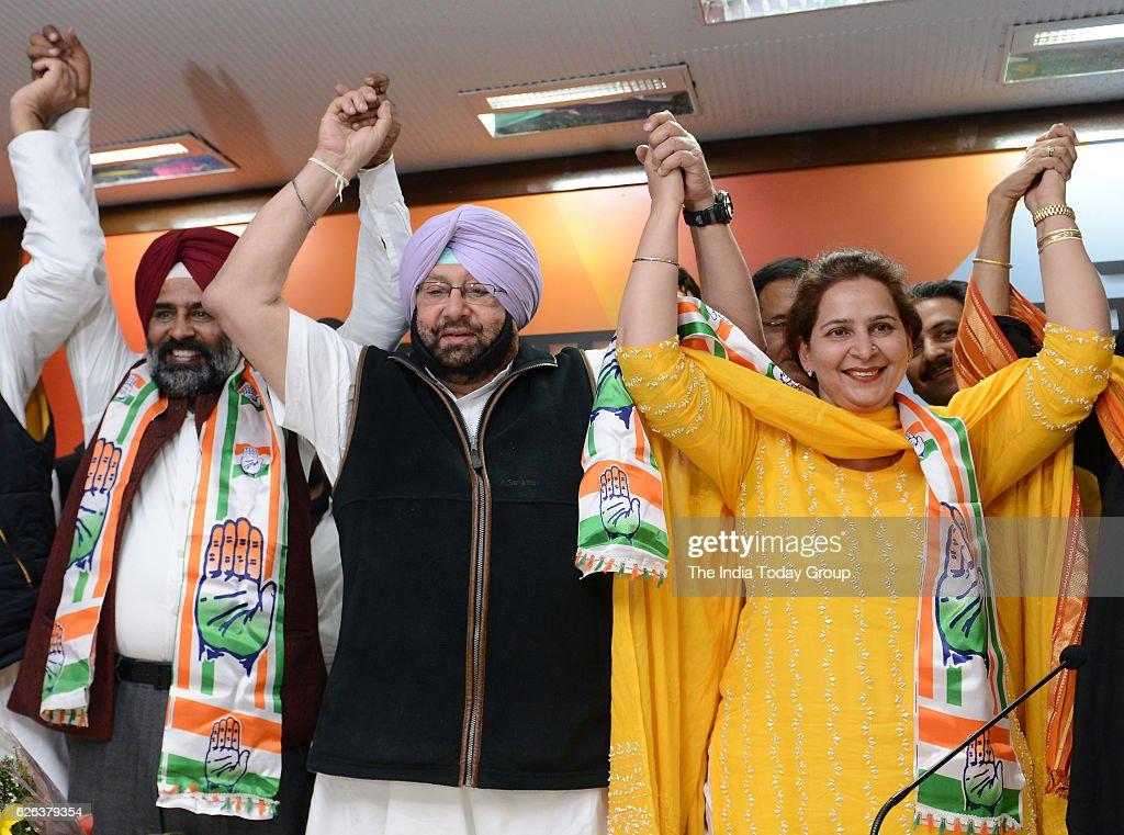Punjab Congress president Captain Amarinder Singh welcomes Cricketerturnedpolitician Navjot Singh Sidhus wife Navjot Kaur Sidhu and former Olympian...