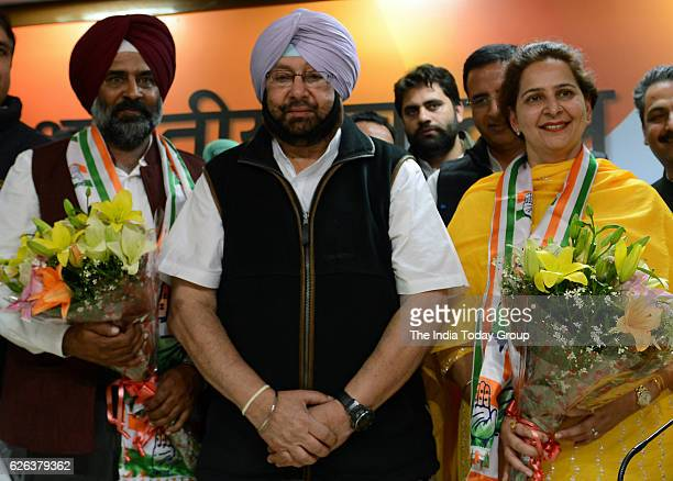 Punjab Congress president Captain Amarinder Singh welcomes Cricketerturnedpolitician Navjot Singh Sidhus wife Navjot Kaur Sidhu and former Olympian...