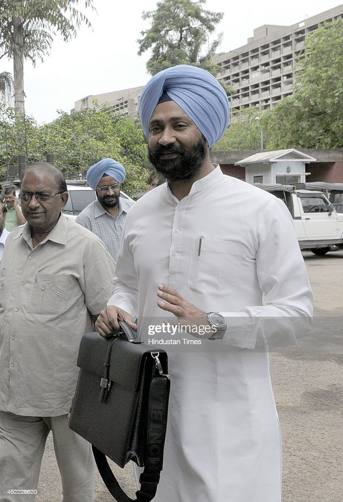 Punjab Finance Minister Parminder Singh Dhindsa on his way to Punjab Vidhan Sabha to present the Budget 2014 during the assembly session on July 16...