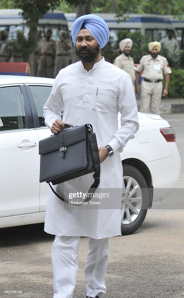Punjab Finance Minister Parminder Singh Dhindsa on his way to Punjab Vidhan Sabha Sector 1 to present the Budget 2014 during the assembly session on..